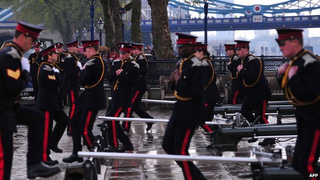 Soldiers prepare to fire a salute at the Tower of London