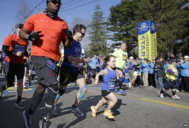 Mobility impaired runners leave the start line at the Boston Marathon, April 21