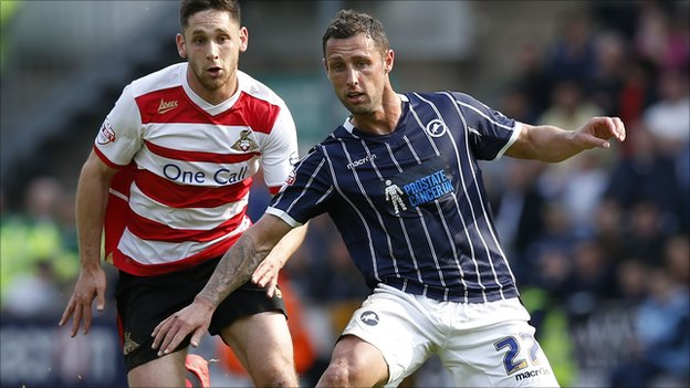 "Millwall's Scott McDonald (right) takes the ball past Doncaster""s Dean Furman (left)"