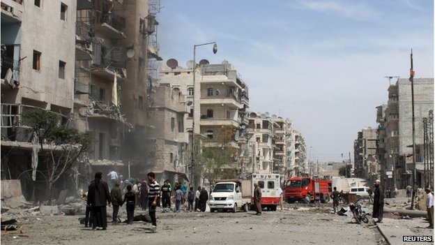 Men inspect a site hit by what activists said was a barrel bomb dropped by pro-Assad forces in the Dahra Awad neighbourhood of Aleppo April 20