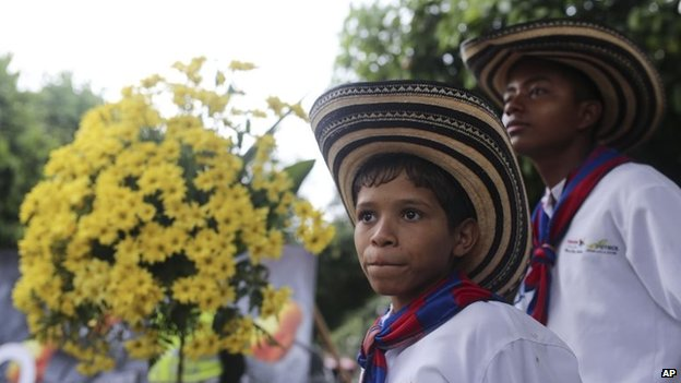 Boys from a music band attend a symbolic funeral in Aracataca, Monday, April 21, 2014