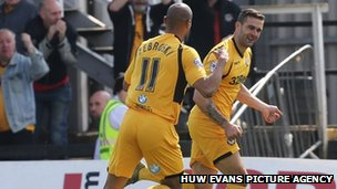 Newport County players celebrate taking the lead against Burton