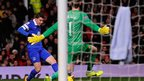 Bryan Oviedo scores against David de Gea for Everton