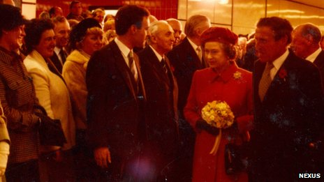 Desmond Fletcher showing Her Majesty The Queen around Gateshead Interchange at the official opening of Metro