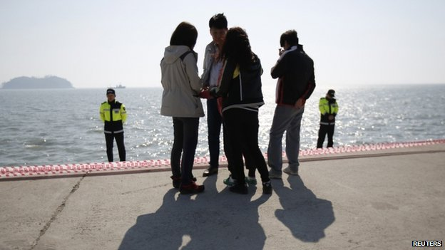 Family members of missing passengers who were on the ferry wait for news of their loved ones at Jindo