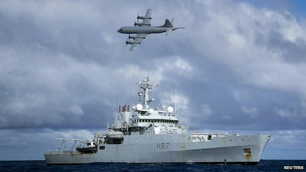 An RAAF AP-3C Orion aircraft flies past British naval ship HMS Echo in the Indian Ocean as they continue to search for missing Malaysia Airlines flight MH370 - 15 April 2014