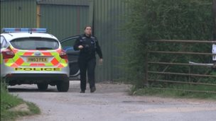 Policewoman at the industrial storage unit in West Wellow, Romsey
