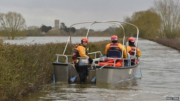 Boat operated by emergency services heading toward Muchelney