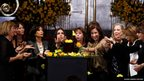 Women blow yellow rose petals over an urn containing the ashes of late Colombian Nobel laureate Gabriel Garcia Marquez during a public viewing in the Palace of Fine Arts in Mexico City