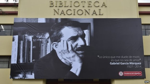 A large photograph of late Colombian 1982 Nobel Prize in Literature laureate Gabriel Garcia Marquez hangs over the entrance to the National Library in Bogota on 21 April, 2014