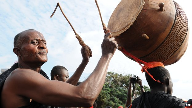 A Ghanaian playing the drum for mourners - August 2012