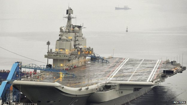 China's first aircraft carrier - the 60,000-tonne Liaoning, which was renovated from an old aircraft carrier that China bought from Ukraine in 1998 - is seen docked at Dalian Port, in Dalian, Liaoning province (September 2012)