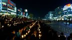 People hold candles at a vigil in central Ansan for students among the missing passengers of the capsized ferry - 22 April 2014