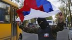 A masked pro-Russia protester waves the Russian flag in Donetsk, eastern Ukraine, on 22 April 2014