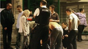 Police talk to a man assaulted outside a nightclub