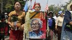 "A senior leader of Myanmar opposition leader Aung San Suu Kyi""s National League for Democracy party carries a portrait of Win Tin while marching with fellow NLD members to Ye-Way cemetery to attend the funeral of Win Tin in Yangon, Myanmar on Wednesday, 23 April, 2014"