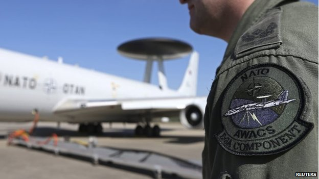 The patch of the NATO AWACS (Airborne Warning and Control Systems) aircraft is seen attached to the uniform of an officer before boarding for a surveillance flight over Romania from the AWACS air base in Geilenkirchen, near the German-Dutch border April 16