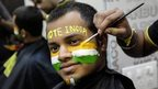 "A man poses as he gets his face painted ahead of the sixth phase of India""s general election in Mumbai April 23, 2014."