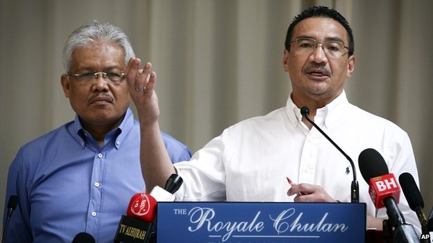 Malaysian Deputy Minister of Foreign Affairs Hamzah Zainudin, left, listens as Malaysia's acting Transport Minister Hishammuddin Hussein talks during a press conference in Kuala Lumpur - 19 April 2014