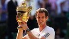 Andy Murray holds the Wimbledon trophy aloft