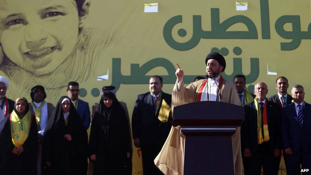 Ammar al-Hakim, the head of the Islamic Supreme Council of Iraq (ISCI), speaks to supporters during an election rally on 19 April 2014 in the Iraqi city of Karbala