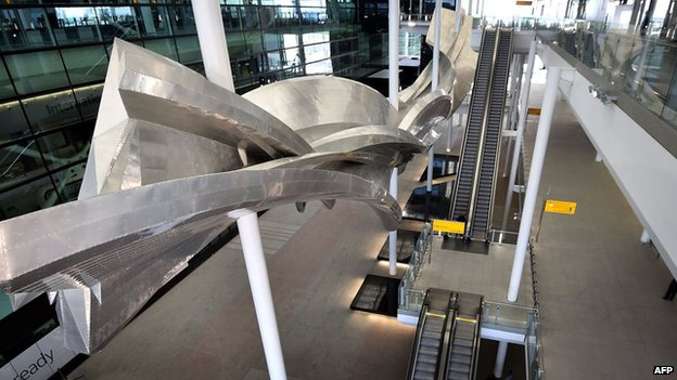 "British artist Richard Wilson's sculpture entitled ""Slipstream"" in the new Terminal Two at Heathrow Airport"