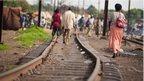 People walk along the train tracks in Lubumbashi, the mining capital of the Democratic Republic of the Congo - 2011