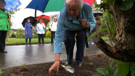 WI members planting poppies
