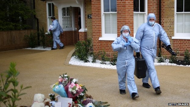 Police forensic officers were at the house in New Malden