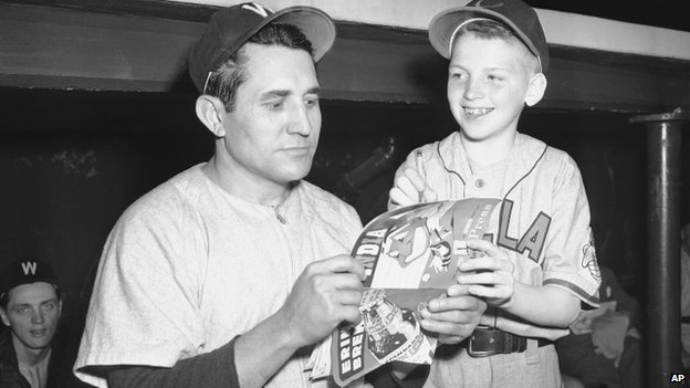 Washington Senators pitcher Conrado Marrero stands with Cleveland Indians bat boy Own McGinty in May 25, 1950