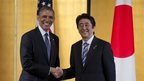 President Barack Obama and Japanese Prime Minister Shinzo Abe shake hands as they arrive to participate in a bilateral meeting at the Akasaka State Guest House in Tokyo on 24 April 2014