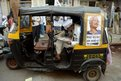 a supporter of Indian activist and Aam Aadmi Party (AAP) candidate Medha Patkar reads a newspaper as he sits in an auto rickshaw outside the party office in Mumbai.