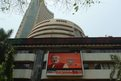 The television screen on the facade of the Indian Bombay Stock Exchange (BSE) building features Chief Minister of the Indian state of Gujarat and Bharatiya Janata Party (BJP) prime ministerial candidate Narendra Modi