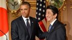 US President Barack Obama shakes hands with Japanese Prime Minister Shinzo Abe following a bilateral press conference at the Akasaka Palace in Tokyo on 24 April 2014