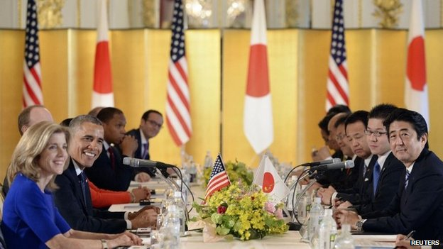 US President Barack Obama speaks to Japanese Prime Minister Shinzo Abe during their meeting at the Akasaka Palace in Tokyo on 24 April 2014
