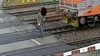 Man walks in front of train