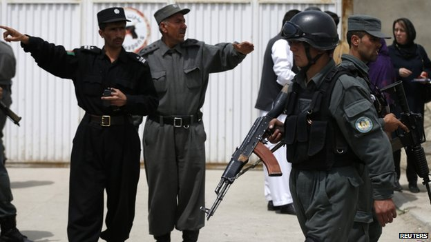 Afghan police outside the Cure hospital in the aftermath of the attack