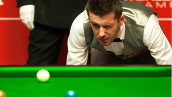 Mark Selby eyes his next shot during the first round of the World Snooker Championship 2014