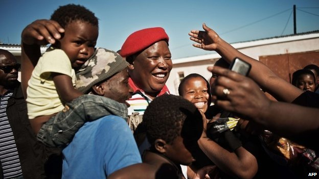 South African political party Economic Freedom Fighters leader Julius Malema (C) greets supporters in Ngcingwane in the Eastern Cape province of South Africa, on 11 April 11 2014