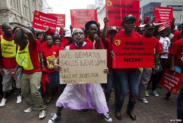 Members of the National Union of Metal Workers of South Africa (NUMSA) protest as they march through Durban (19 March 2014)
