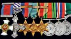 Some of Mr Berry's medals including Distinguished Service Order (Left) and Distinguished Flying Cross (second left)
