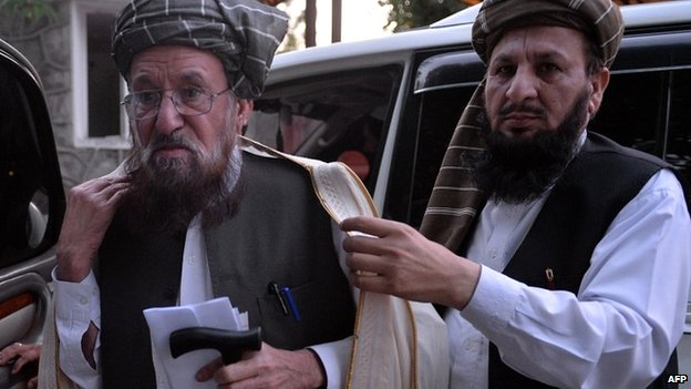 Members of the Taliban's negotiating committee arrive to brief media in Islamabad - 23 April 2014