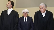 Bernie Ecclestone, center, stands with his lawyers in court in Munich, southern Germany - 24 April 2014