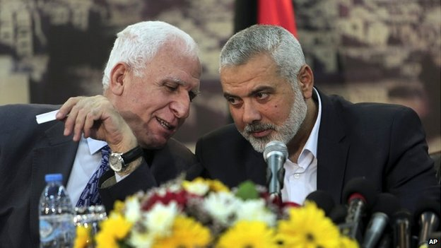 Senior Fatah official Azzam al-Ahmad, left, talks to Gaza's Hamas Prime Minister Ismail Haniya - 23 April 2014