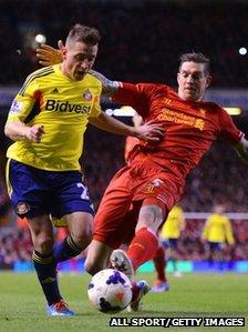 Daniel Agger of Liverpool challenges Emanuele Giaccherini of Sunderland