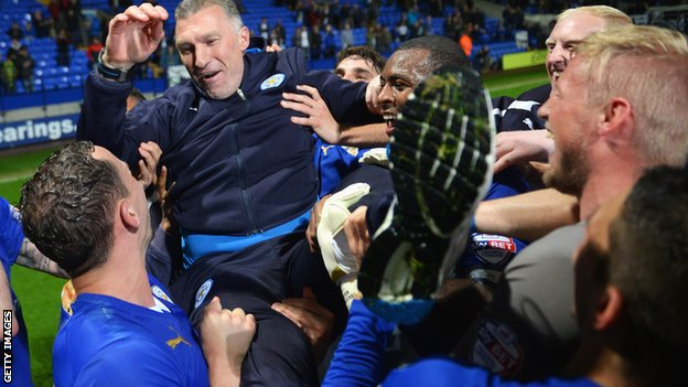 Nigel Pearson celebrates Championship title win with Leicester players.