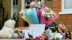 Teddies, bouquets, pot plants and a child's skipping rope were among items laid on the driveway of the house