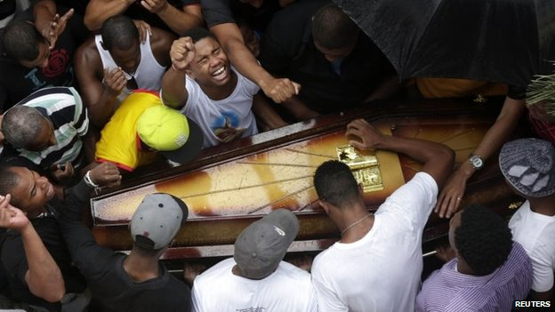 Relatives and friends of Douglas Rafael da Silva Pereira mourn during his burial in Rio de Janeiro, April 24, 2014.