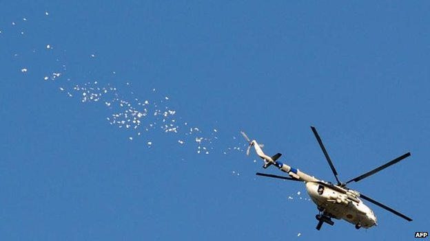 Ukrainian helicopter drops leaflets over Sloviansk, 24 April