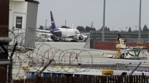 A worker moves equipment near gates used by Hawaiian Airlines at Terminal A of Mineta San Jose International Airport San Jose, California 21 April 2014